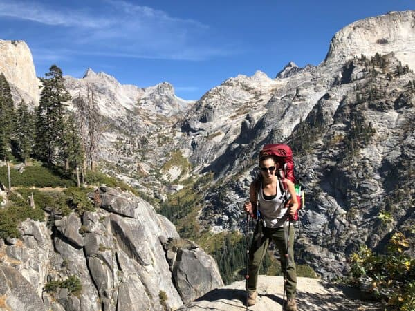 hiker with backpack and mountains in the backgorund